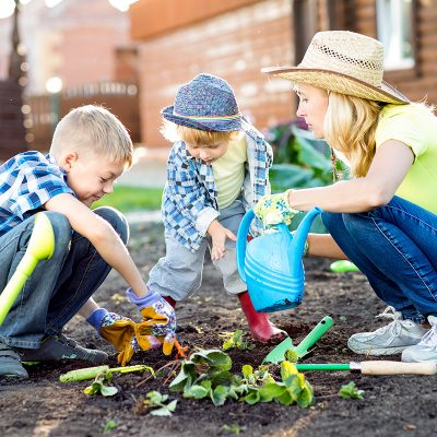 Mother gardening with kids